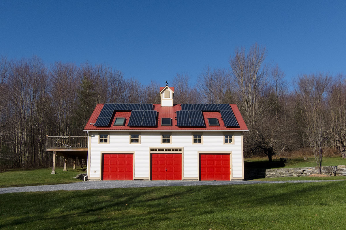 Barn style home with solar panels on the roof