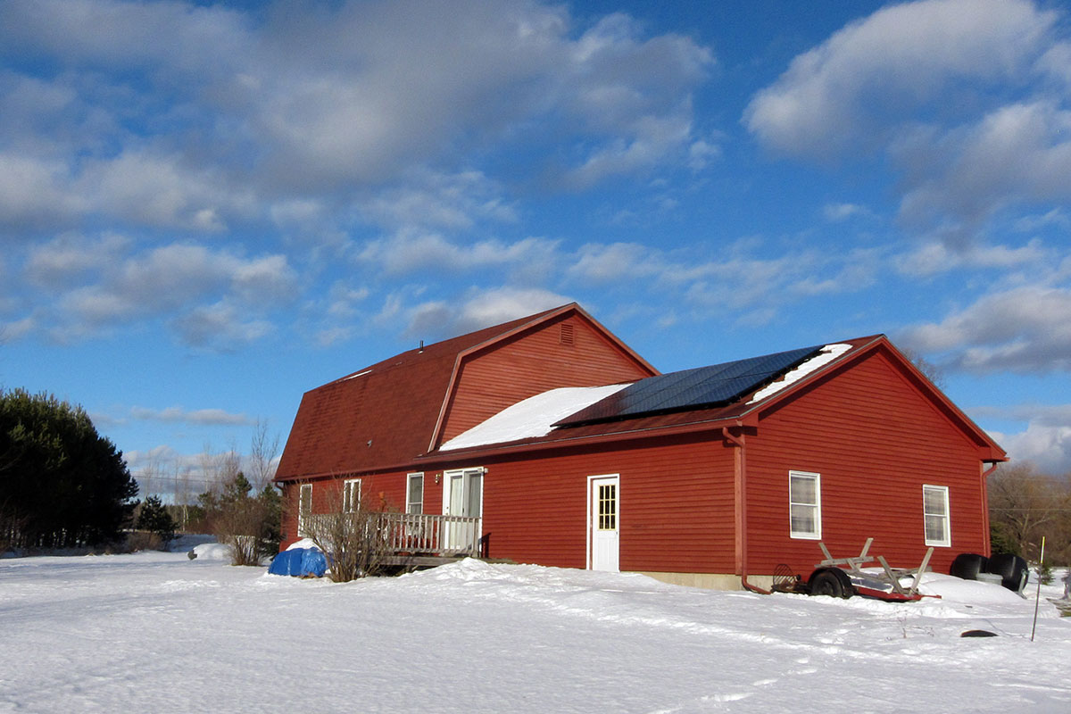 Large barn turned into a house with solar panels on the roof