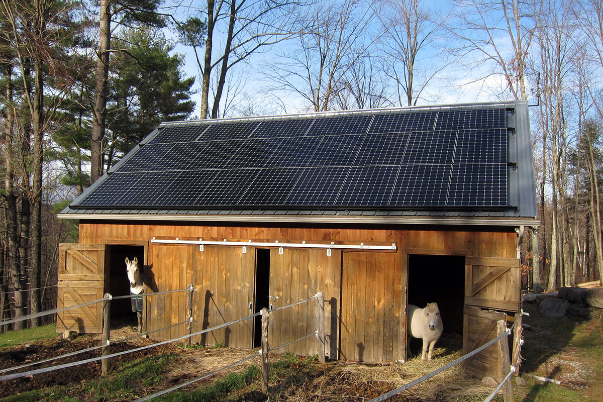 Horse barn with solar panels on the roof