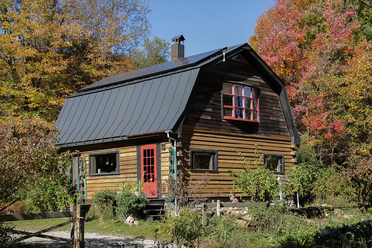 Cabin in Vermont with solar panels on top roof