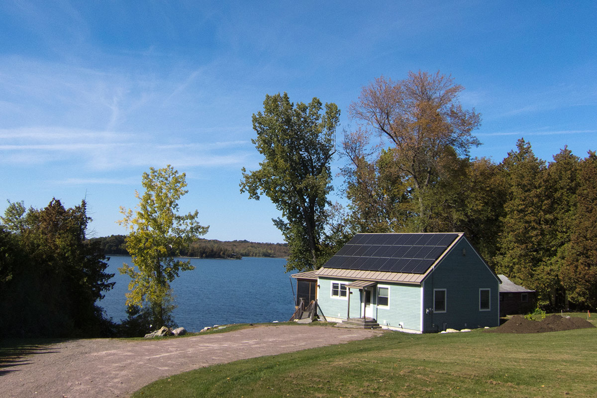 Small Vermont home with solar panels on roof in South Hero