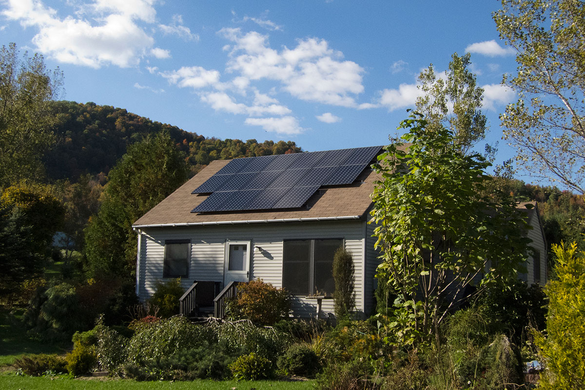 Cape style home with solar on roof