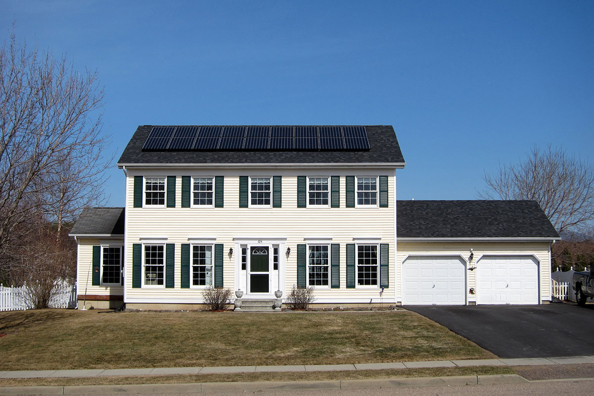 Colonial home with solar panels on roof in Essex Junction