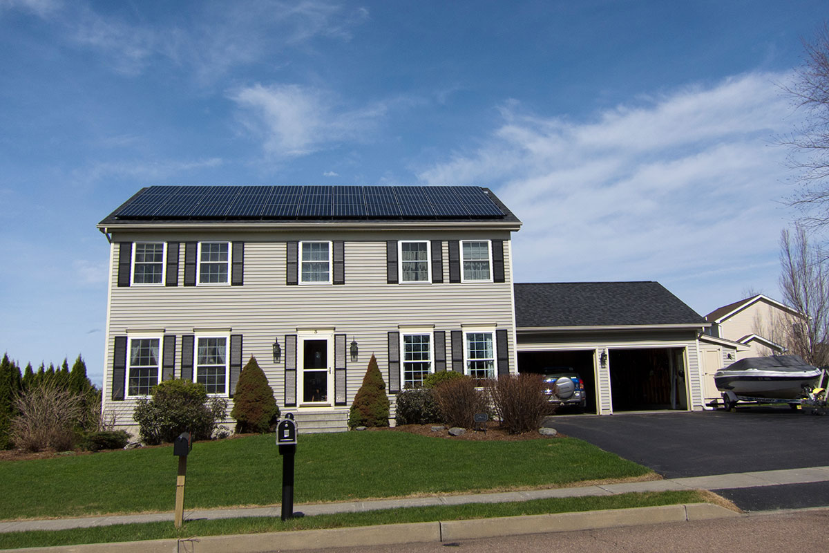 Colonial home with solar panels Essex Junction