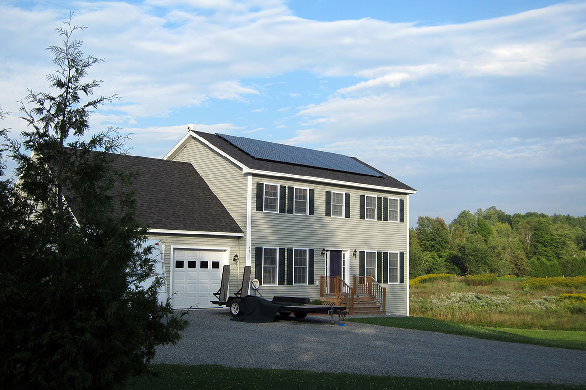 Colonial VT Home with solar panels on roof