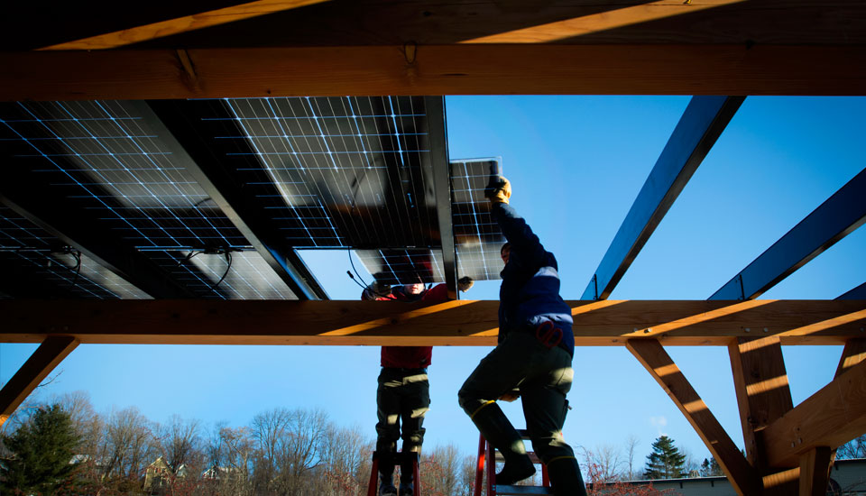 placing the panels at the Hunger Mountain solar canopy install