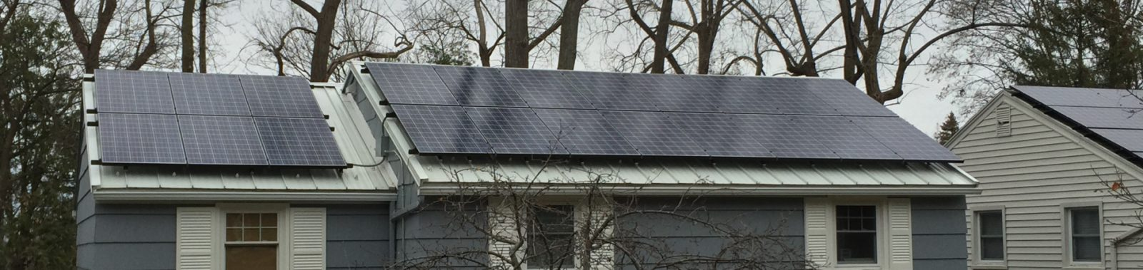 NY house with residential solar from front yard