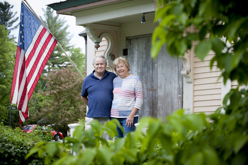 Solar homeowners with American flag