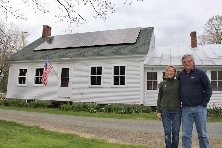 Solar homeowners in front of their house in Danville