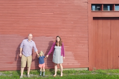 Family in front of their barn