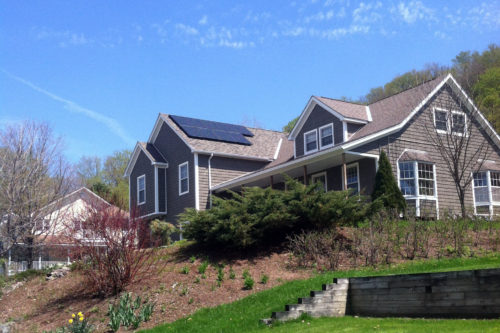 Home in St. Albans with a solar array on the roof