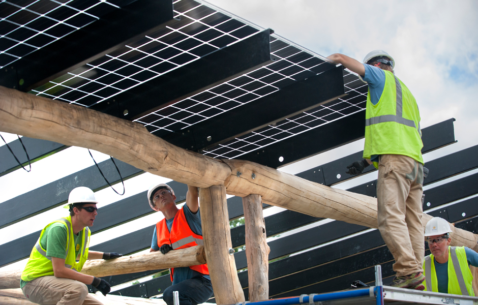 Dual Sided solar panels going up over VT Artisan parking lot