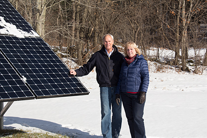 Paul and Brenda in Richmond Vermont with their Solar Array