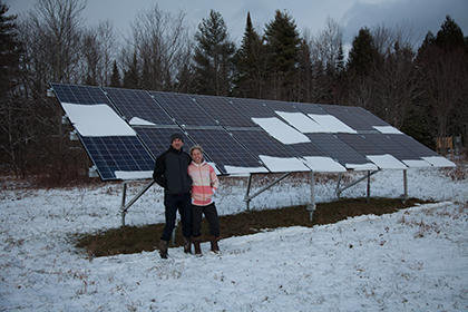 The Petterssen's in front of their solar array in Plainfield VT