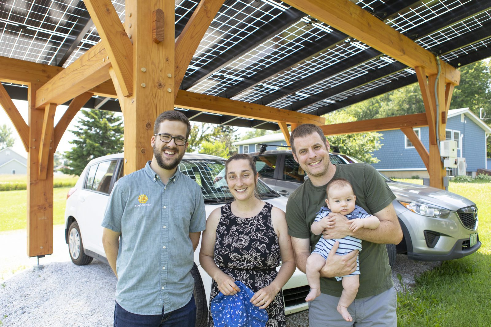 family under solar power canopy in vermont