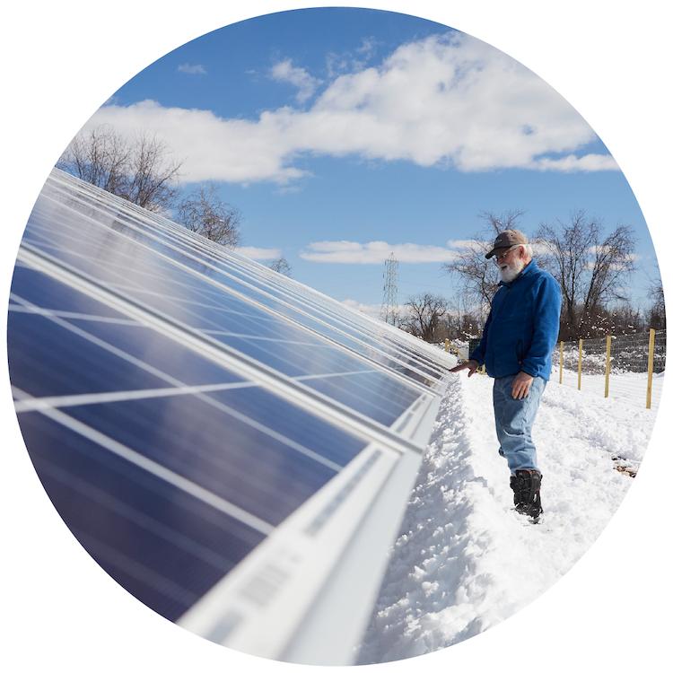 CSA Member Touches Solar Panels